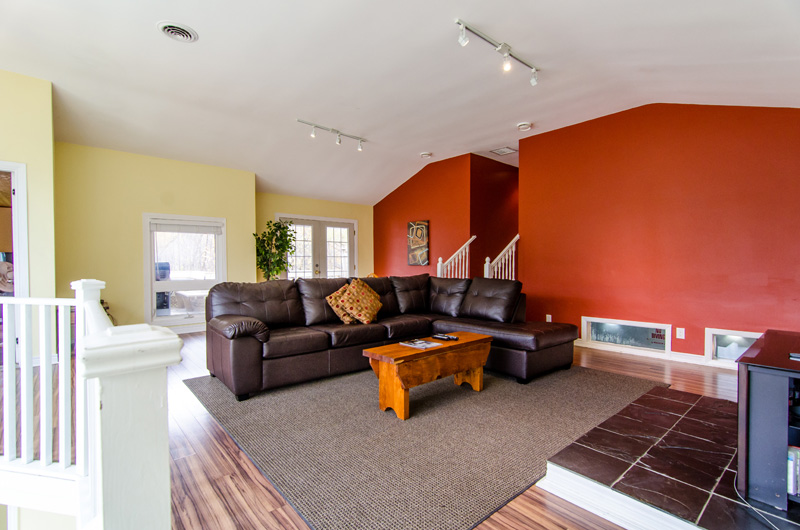 This Stay at Blue Mountain chalet offers a luxury leather seating area with lots of natural light in the living room in the Claire Glen location