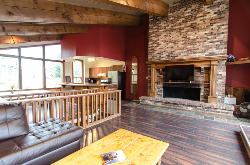 The top floor of the Mountain View 1 chalet comes with a huge wood burning brick fireplace and is available for booking from Stay at Blue Mountain