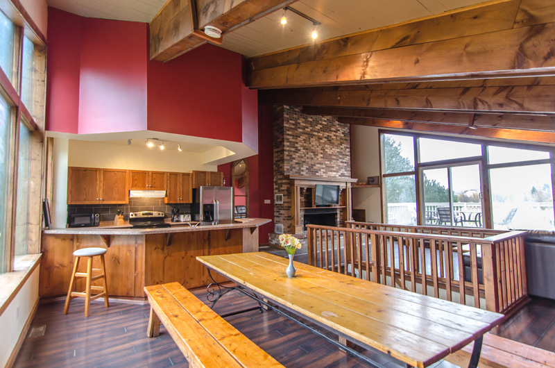 Stay at Blue Mountain - open concept dining area with an entrance to the patio in this chalet located at Mountain View 1