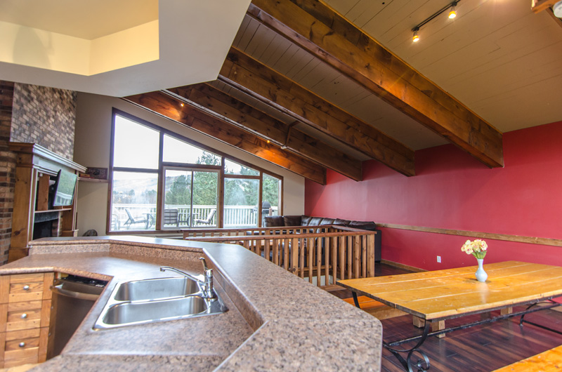 The top floor in the Mountain View 1 chalet is an open-concept format and is available for rent from Stay at Blue Mountain