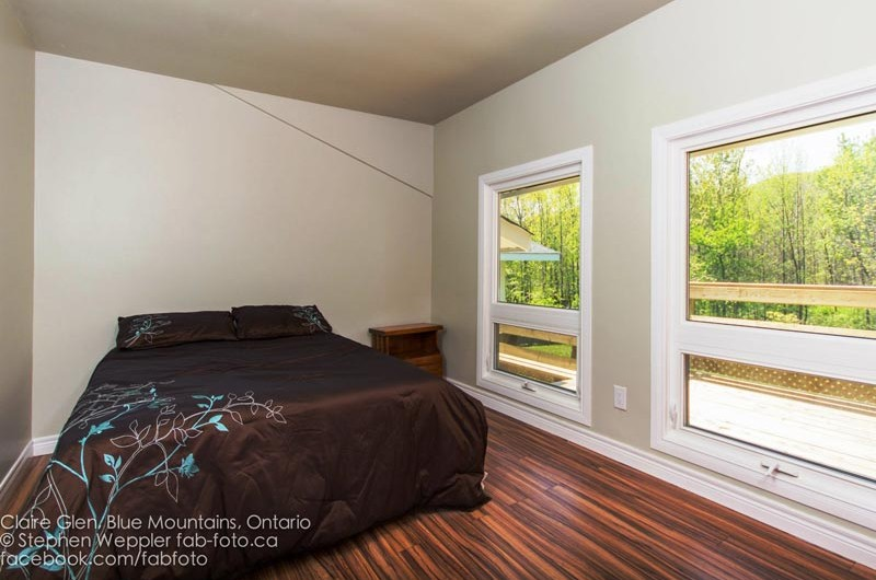 Stay at Blue Mountain chalet offers cozy bedroom with full beds such as the one pictured here from Claire Glen