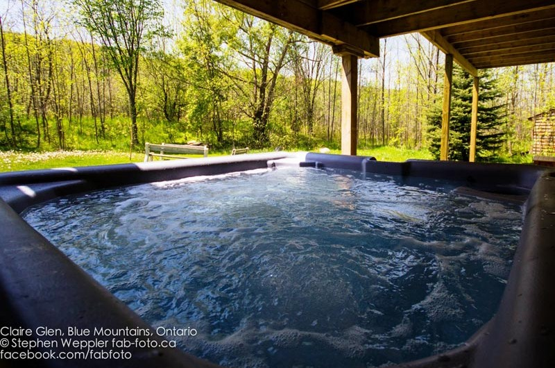 For added comfort, this Stay at Blue Mountain chalet located at Claire Glen provides an outdoor hot tub to steam and relax in