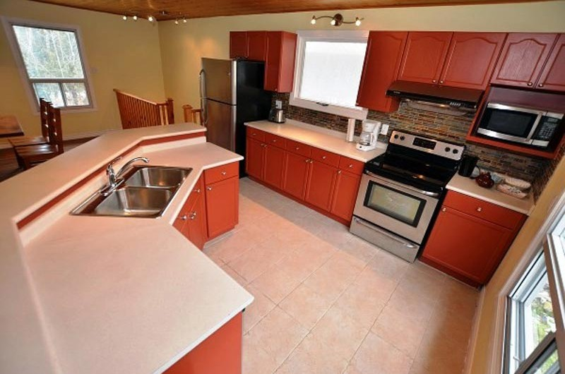 Full kitchen amenities are included in the Claire Glen chalet offered from Stay at Blue Mountain