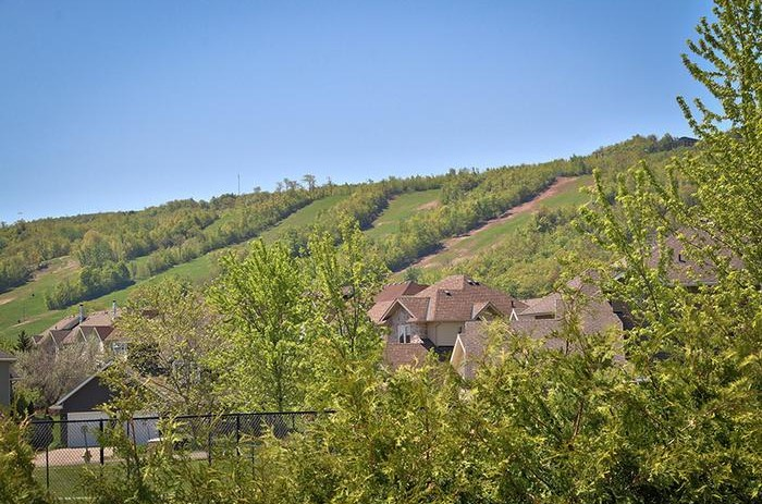 The 106 Birchview chalet has a beautiful view of the mountains and is available for rent from Stay at Blue Mountain