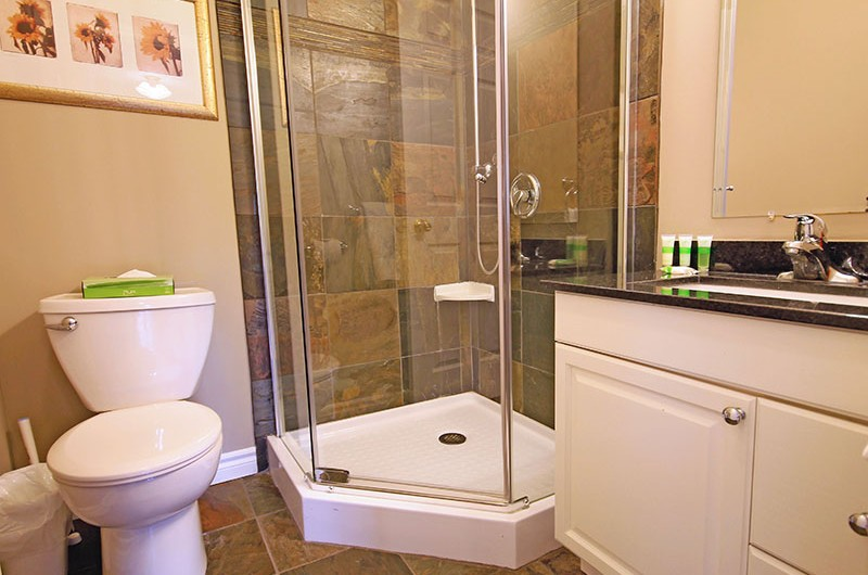 One of the luxurious four bathrooms in the 106 Birchview Chalet that is available for rent from Stay at Blue Mountain