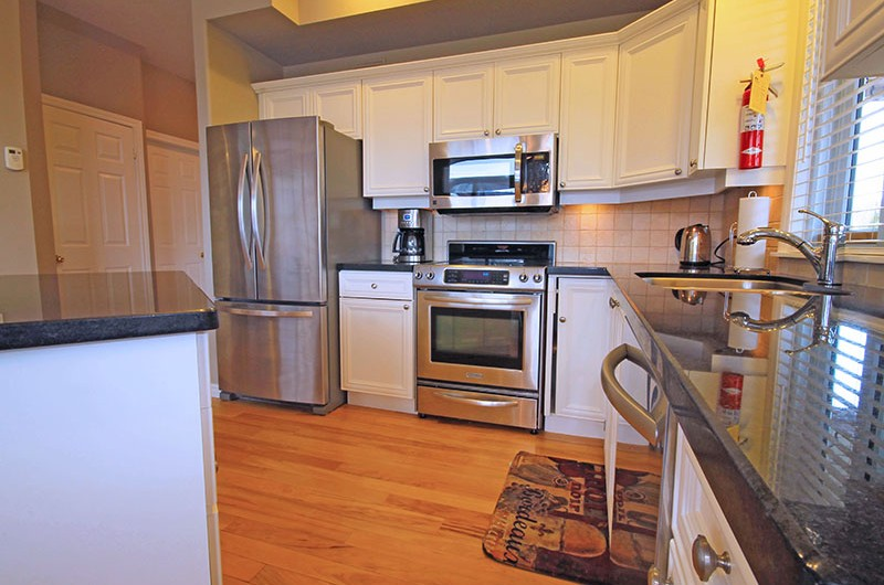 Stay at Blue Mountain offers kitchens such as pictured here at the 106 Birchview chalet that are fully equipped with nicely updated quartz countertops and stainless steel appliances