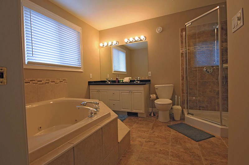 Stay at Blue Mountain chalet offers a luxurious bathroom that features a jet bathtub with separate shower in 106 Birchview