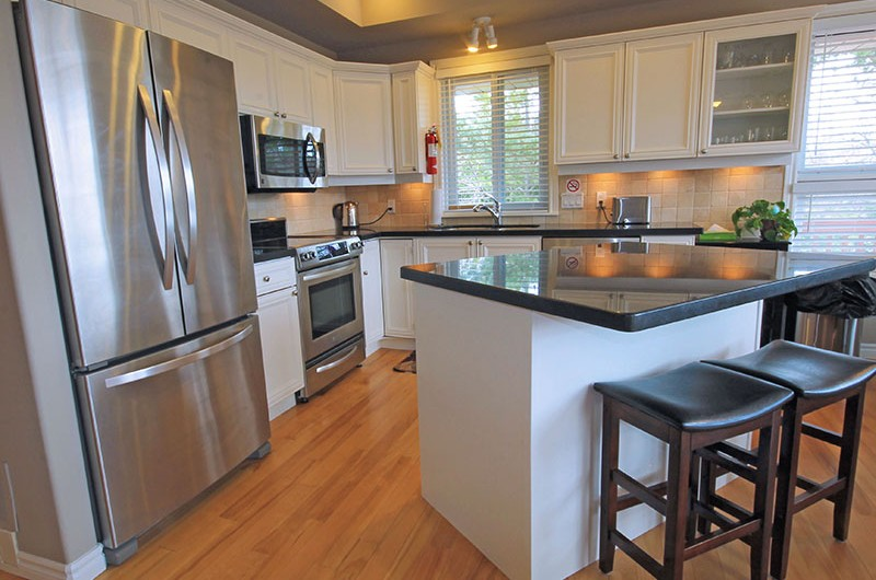 A fully-equipped and high-end kitchen in a Stay at Blue Mountain chalet rental available at 106 Birchview