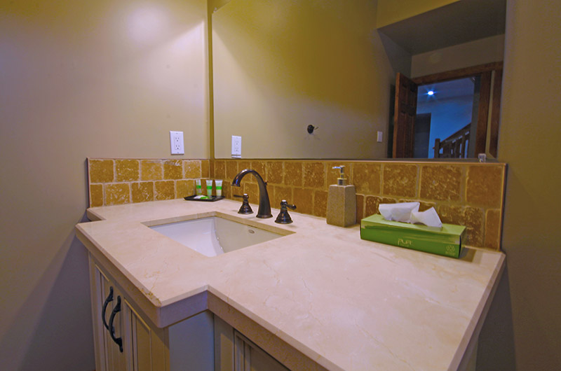 The lower level bathroom with a modern-styled sink in the 109 Plater St chalet from Stay at Blue Mountain