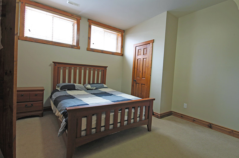 Stay at Blue Mountain offers tons of natural light in this lower level bedroom in the 109 Plater St location