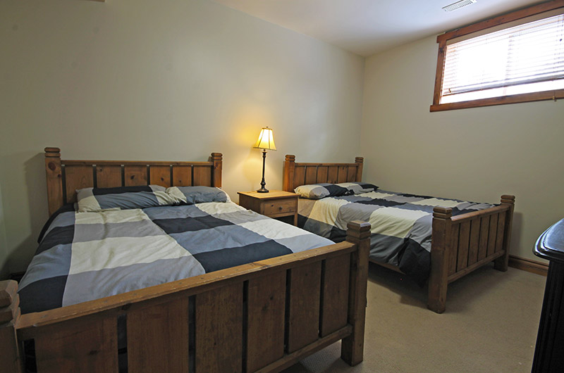 Stay at Blue Mountain offers two full beds in this cozy bedroom found in the 109 Plater St chalet