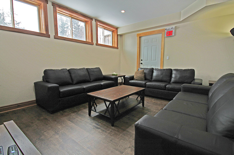 Leather seating in the lower level of the 109 Plater St chalet is available from Stay at Blue Mountain for rental