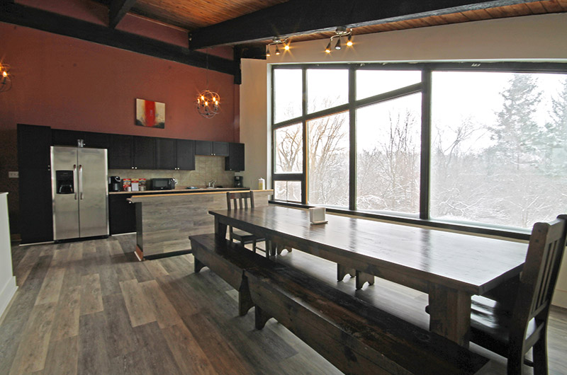 This Stay at Blue Mountain chalet offers a very spacious dining area with natural light - located at Mountain View 2
