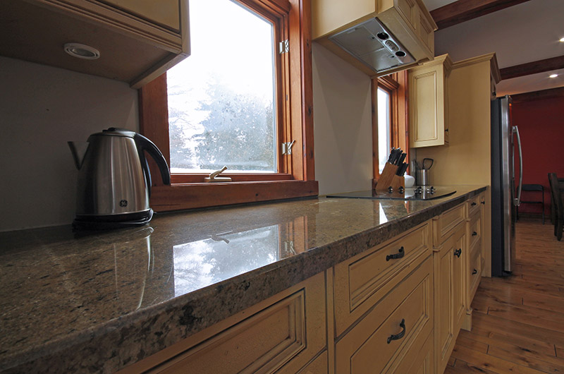 Full kitchen amenities are included in the 109 Plater St chalet offered from Stay at Blue Mountain