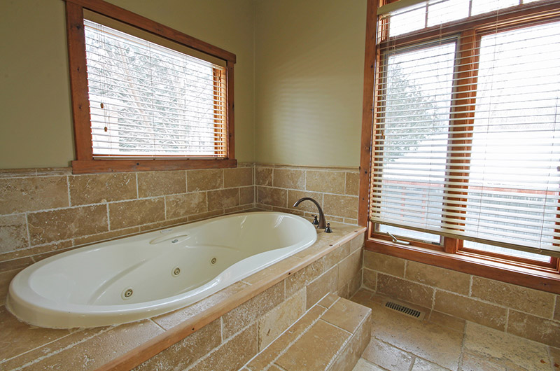 Stay at Blue Mountain offers impressive chalet bathrooms such as the one pictured here with a large tub at 109 Plater St