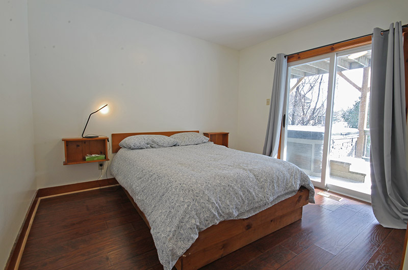 Stay at Blue Mountain chalet offers cozy bedrooms with full beds such as the one pictured here from Summit Ridge 5