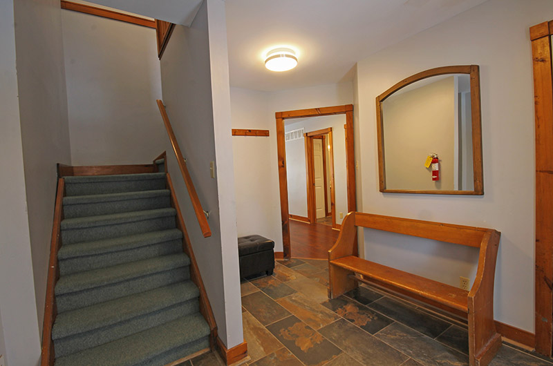 A stairway that leads to the upper level of the Summit Ridge 5 chalet, available for booking from Stay at Blue Mountain