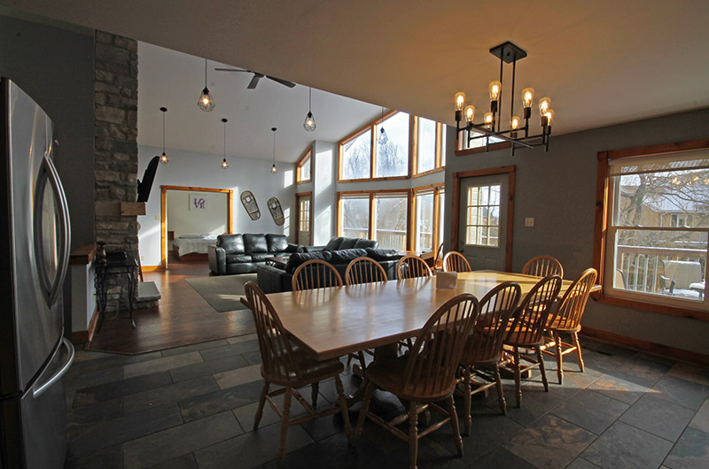 This Stay at Blue Mountain chalet offers a very spacious dining area with natural light - located at Summit Ridge 5