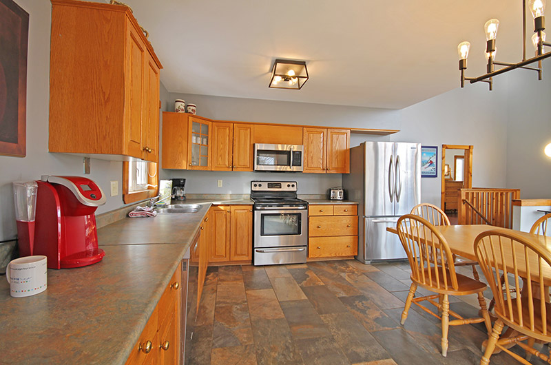 Full kitchen amenities are included in the Summit Ridge 5 chalet offered from Stay at Blue Mountain