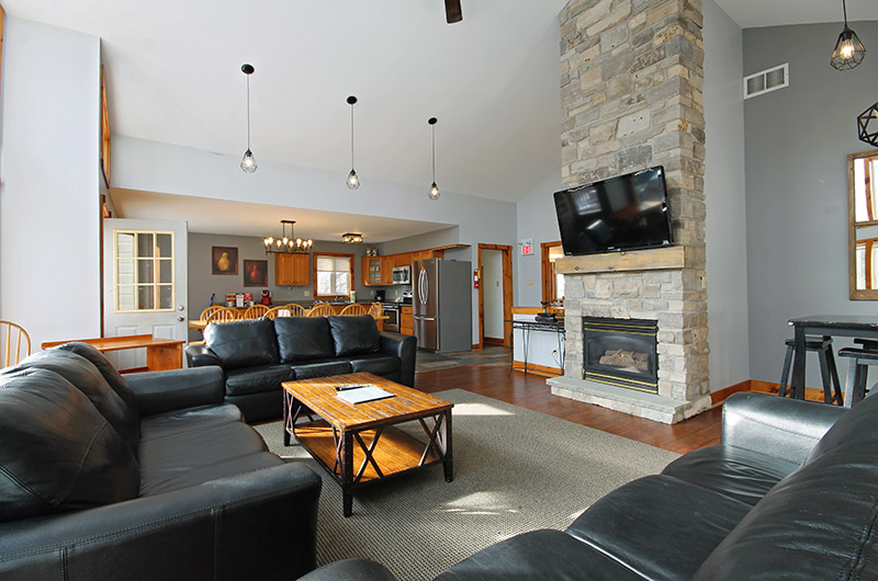Luxury leather seating area in the living room in the 109 Plater St chalet offered from Stay at Blue Mountain