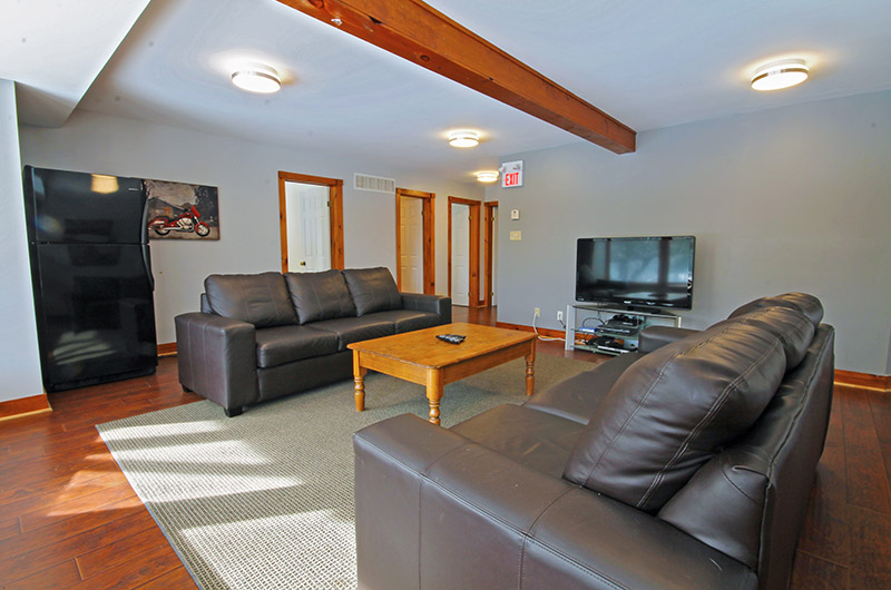 Luxury leather seating area in the upper living room in the Summit Ridge 5 chalet offered from Stay at Blue Mountain