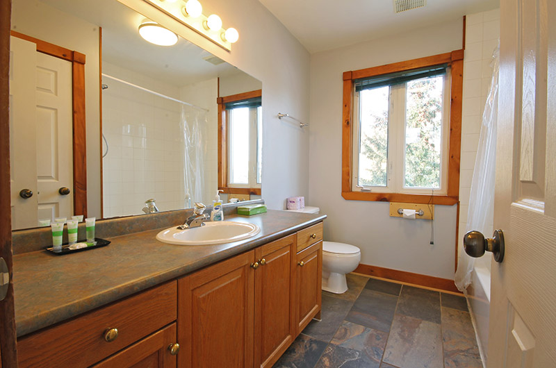One of the luxurious four bathrooms in the Summit Ridge 5 chalet that is available for rent from Stay at Blue Mountain