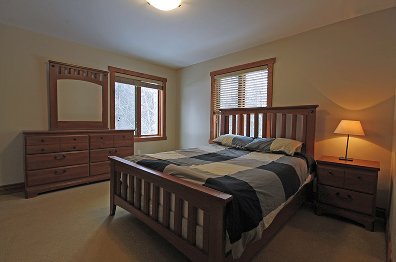 Stay at Blue Mountain offers warm and cozy bedrooms with natural light such as photographed here from the 109 Plater St chalet