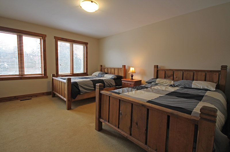 Natural light in this bedroom located at the 109 Plater St chalet with two full beds is available for rent from Stay at Blue Mountain