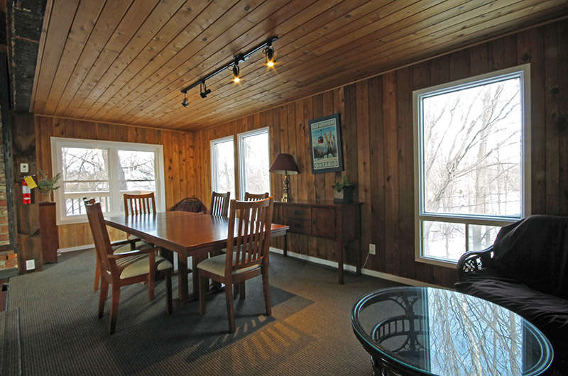 This Stay at Blue Mountain chalet offers a dining area and table with a lot of natural light - located at 128 Birchview