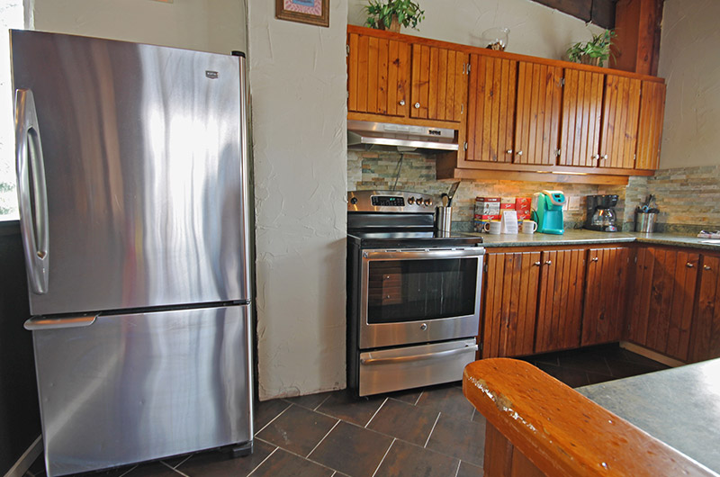Stay at Blue Mountain offers a kitchen at the 128 Birchview chalet that is fully equipped for your use