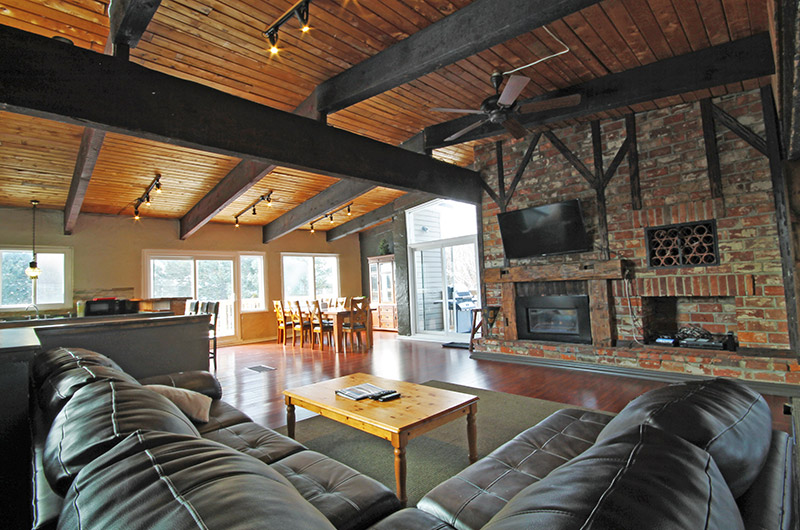 128 Birchview offers a cozy seating area in front of a fireplace in this chalet rental from Stay at Blue Mountain