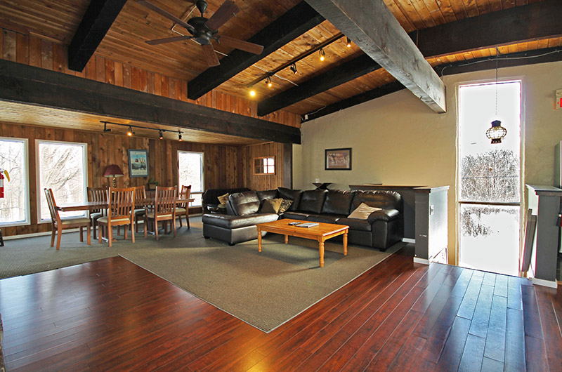 Leather seating beside the dining area in the main floor of the 128 Birchview chalet is available from Stay at Blue Mountain for rental