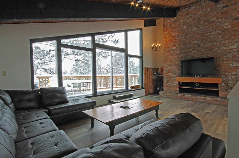 Leather seating in the upper level of the Mountain View 2 chalet is available from Stay at Blue Mountain for booking