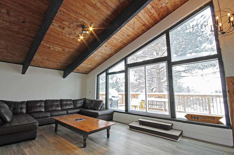 The Mountain View 2 chalet upper floor has a lot of natural light in the seating area with direct access to the upper floor - available for rent from Stay at Blue Mountain