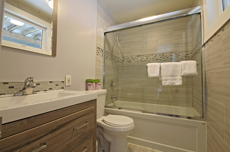 One of the luxurious two bathrooms in the 128 Birchview Chalet that is available for rent from Stay at Blue Mountain