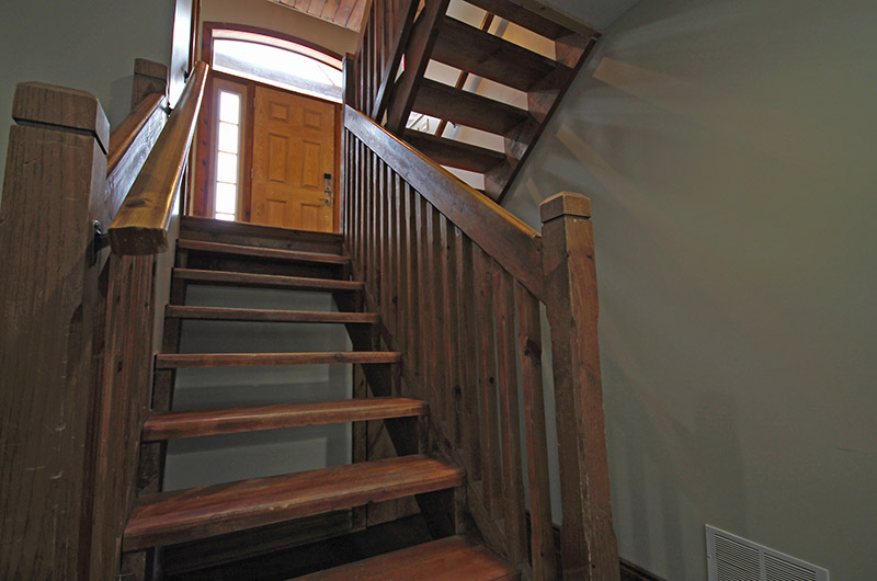A stairway that leads to the lower basement of the 109 Plater St Chalet, available for rent from Stay at Blue Mountain