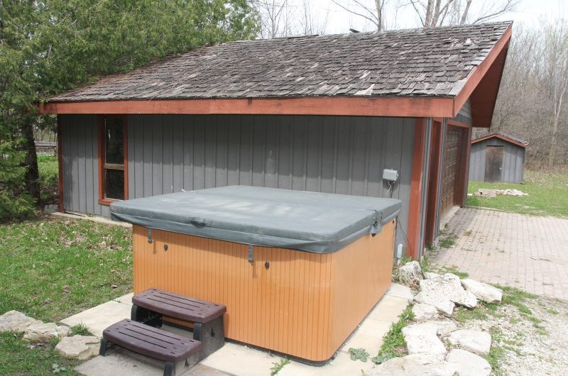 Ski chalet rental from Stay at Blue Mountain comes with an outdoor private hot tub and is located at 109 Plater St